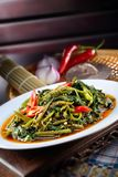 Sambal Kangkong. Traditional Malaysian home cook sambal kangkong dish Royalty Free Stock Photo