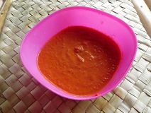 Sambal is a traditional Indonesian sauce. It is made from very hot chilli, tomatoes and spices stock photo