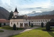 Sambata de Sus monastery. Brancoveanu Monastery in Brasov county Romania, also called Sambata de Sus monastery, with view towards the mountains Stock Photos