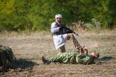 Mujahid attacks the Soviet soldier. SAMBEK, ROSTOV REGION, RUSSIA, AUGUST 19, 2018: Reconstruction of Afghan war. Mujahid attacks the Soviet soldier stock images