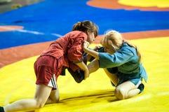 Sambo oder Selbstverteidigung ohne Waffen. Wettbewerbsmädchen Stockbild
