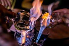 Sambuca et feu Images stock