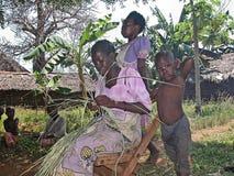 Samburu woman weaving rattan. A woman with children in the village of Samburu tribe - Kenya Stock Images