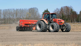 Same Agricultural Tractor and Seeder on Field at Spring Royalty Free Stock Images
