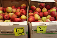Same apples, different prises. Apples in boxes with smiling prices, shot in fruit-shop Stock Photo