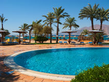 The same color of the pool and the sea. General view from the hotel pool to the Red sea coastline royalty free stock photo