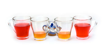 Same cups, different tea. And small teapot Royalty Free Stock Photography