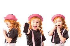 same kid standing with smartphones stock image