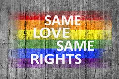 Same Love Same Rights and LGBT flag painted on background texture. Close royalty free stock photography