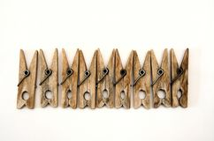The same old wooden clothespins lie in a row stock photography