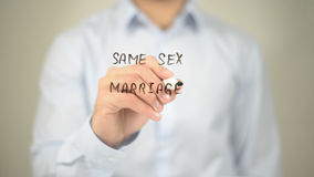 Same Sex Marriage, Man Writing on Transparent Screen Royalty Free Stock Photography