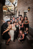 Same Sex Wedding Party. Group from a same sex wedding sitting outside near brick wall Stock Photos