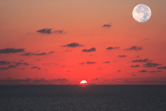 At the same time see the sun and the moon. Fantastically beautiful sunset on the Mediterranean Sea. At the same time see the sun and the moon stock photos