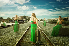 Same woman in different positions with suitcase talking on mobile phone waiting for train. To get away Royalty Free Stock Photos
