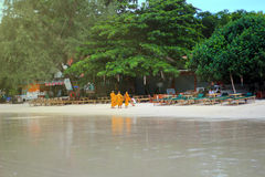 Samed Island, Thailand - May 26, 2013: Tree monks were received food from a Thai lady while go out in the morning. Royalty Free Stock Images