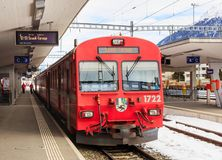 Train of the Rhaetian Railway at the Samedan railway station. Samedan, Switzerland - 3 March, 2017: a passenger train of the Rhaetian Railway company at a Royalty Free Stock Photography