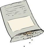 Samen, die aus Paket heraus verschüttet werden Stockfoto