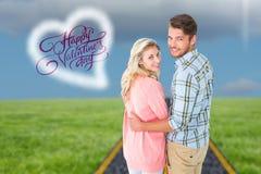 Samengesteld beeld die van aantrekkelijk paar en bij camera draaien glimlachen Royalty-vrije Stock Afbeelding