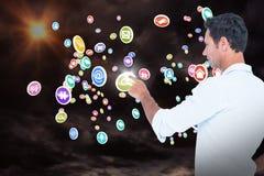 Samengesteld beeld die van de knappe mens iets met zijn 3d vinger richten Stock Afbeeldingen
