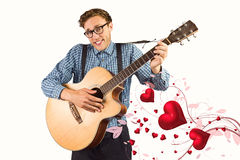 Samengesteld beeld die van geeky hipster de gitaar spelen Stock Fotografie