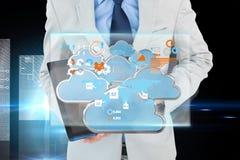 Samengesteld beeld die van geeky zakenman aan 3d tabletpc richten Royalty-vrije Stock Afbeelding