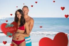 Samengesteld beeld die van het houden van van paar elkaar omhelzen Royalty-vrije Stock Foto's