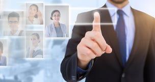 Samengesteld beeld die van zakenman zijn vinger richten op camera Stock Foto