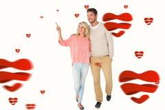 Samengesteld beeld van aantrekkelijk en paar die glimlachen lopen Stock Fotografie