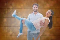 Samengesteld beeld van aantrekkelijk jong paar die pret hebben Royalty-vrije Stock Foto