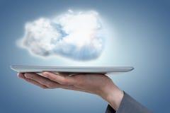 Samengesteld beeld van bebouwd beeld van 3d de tabletcomputer van de zakenmanholding Stock Fotografie