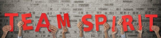 Samengesteld beeld van bebouwde hand van het alfabet a van de onderneemsterholding Royalty-vrije Stock Foto