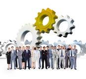 Samengesteld beeld van bedrijfsmensen die opstaan Stock Foto's