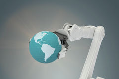 Samengesteld beeld van beeld van 3d de bol van de machineholding Stock Fotografie
