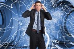 Samengesteld beeld van beklemtoonde zakenman met handen op hoofd Royalty-vrije Stock Fotografie