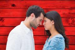 Samengesteld beeld van boos paar die bij elkaar staren Royalty-vrije Stock Afbeelding