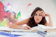 Samengesteld beeld van bored student die haar thuiswerk doen Royalty-vrije Stock Afbeeldingen
