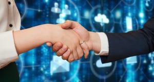 Samengesteld beeld van collectieve partners die handen schudden Stock Afbeelding