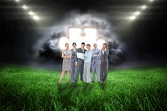 Samengesteld beeld van commercieel team die camera bekijken Royalty-vrije Stock Foto