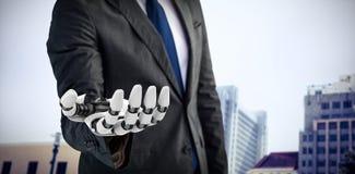 Samengesteld beeld van computer grafisch beeld van zakenman met robotachtige 3d hand Royalty-vrije Stock Foto