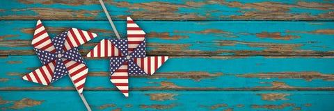 Samengesteld beeld van 3d beeldsamenstelling van vuurrad met Amerikaans vlagpatroon Stock Foto