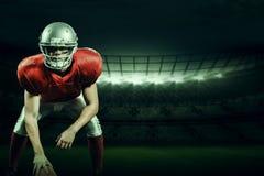 Samengesteld beeld van de Amerikaanse helm van de voetbalsterholding Royalty-vrije Stock Foto's