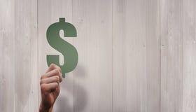 Samengesteld beeld van de dollarteken van de handholding Stock Fotografie