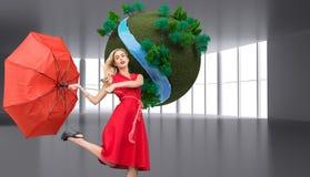 Samengesteld beeld van de elegante paraplu van de blondeholding Royalty-vrije Stock Foto