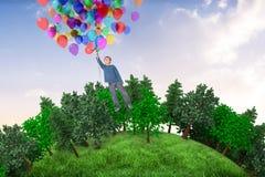 Samengesteld beeld van de leuke ballons van de jongensholding Royalty-vrije Stock Afbeelding