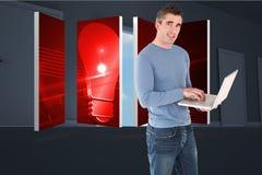 Samengesteld beeld van de mens die laptop met behulp van Stock Afbeelding