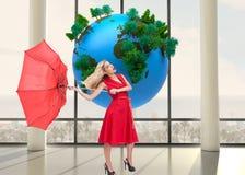 Samengesteld beeld van de paraplu van de blondeholding Royalty-vrije Stock Foto's
