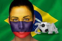 Samengesteld beeld van de voetbalventilator van Colombia in gezichtsverf Royalty-vrije Stock Foto's