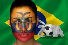 Samengesteld beeld van de voetbalventilator van Ecuador in gezichtsverf Royalty-vrije Stock Afbeeldingen