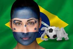 Samengesteld beeld van de voetbalventilator van Honduras in gezichtsverf Royalty-vrije Stock Afbeeldingen