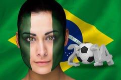Samengesteld beeld van de voetbalventilator van Nigeria in gezichtsverf Stock Foto